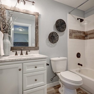Residential bathroom that receives plumbing services in Winchester, VA